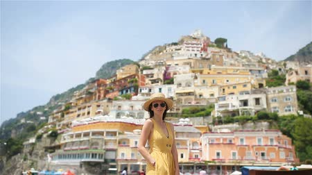 amalfi : Summer holiday in Italy. Young woman in Positano village on the background, Amalfi Coast, Italy