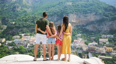 positano : Summer holiday in Italy. Young woman in Positano village on the background, Amalfi Coast, Italy