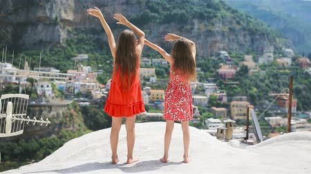 positano : Adorable little girls on warm and sunny summer day in Italy