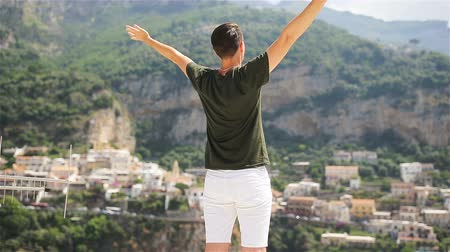 costiera amalfitana : Summer holiday in Italy. Young man in Positano village on the background, Amalfi Coast, Italy