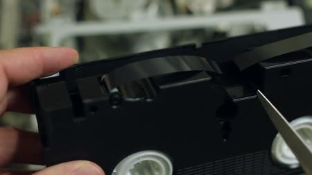 videocassette : videotape scissors cut, destruction of vhs video