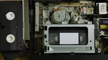 videocassette : VHS cassette player goes out and pressed eject button