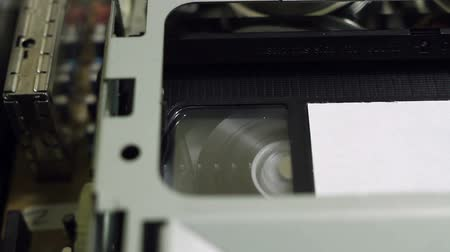 videocassette : VHS tape is rewound to the VCR