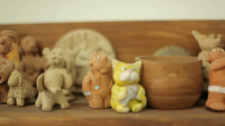 souvenirs : Clay toys and souvenirs stand on the shelf. Handmade folk art