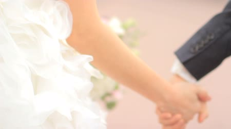 ulita : bride takes the grooms hand. Wedding couple holding hands