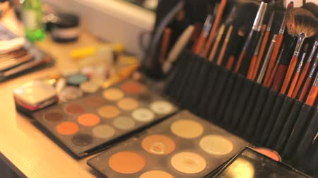 változatos : Professional cosmetics makeup on the table in the studio. Professional makeup brushes.