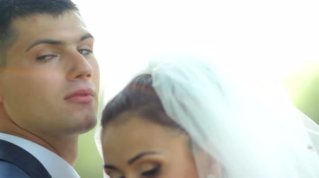 parentes : beautiful newlyweds gently embrace. young couple in love . wedding day