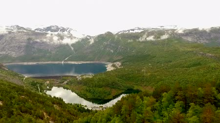 survey : Norway. beautiful landscape of Norway. Blue lake in the background of mountains and forests Stock Footage