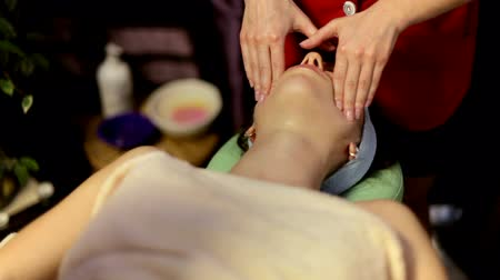 massager : girl is doing a facial massage at the spa. Stock Footage