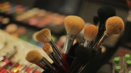 változatos : Professional cosmetics in the salon of a make-up artist. cosmetic brushes close-up Stock mozgókép