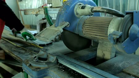 размеры : plastic windows. Worker Cutting PVC Profile with Circular Saw.PVC windows and doors manufacturing.