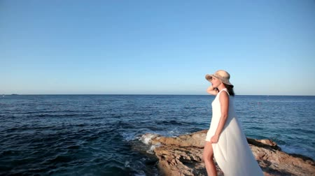 hayran olmak : Beautiful woman with a long white dress walk on seashore, pregnant