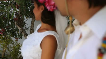 bride and groom kiss . boho style. greece