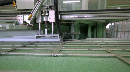Line production of plastic windows. Plastic window frames move along the production line.