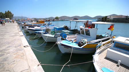 Greece. Beautiful sea coast. Ships and boats in the harbor. Stock mozgókép
