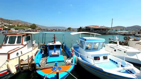 Summer holidays in Greece. Ships and boats in the harbor. Stock mozgókép