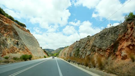 POV car travel across coastal scenery, mediterranean coast curvy asphalt road with landslide rocks.