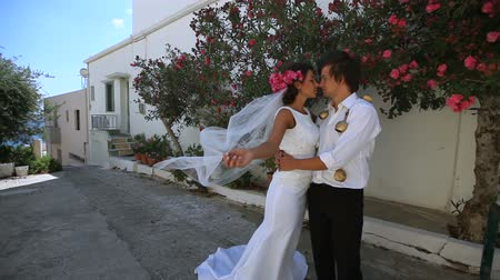 grecja : beautiful newlywed couple. bride and groom are in love.