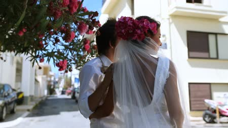Beautiful newlyweds on the street. Stock mozgókép