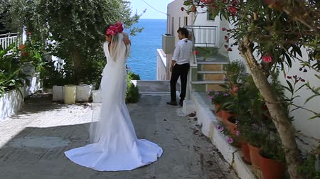 Beautiful newlyweds on street Greece. Stock mozgókép