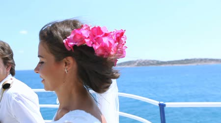 fidelity : Bride and groom running along the waterfront on the background of the sea. Stock Footage
