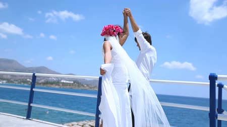 gracefully : wedding dance. newlyweds are dancing on the waterfront. Stock Footage