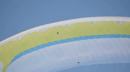 padák : The paraglider is ready for the flight. Competitions of paragliders on the frozen lake. Ternopil Ukraine
