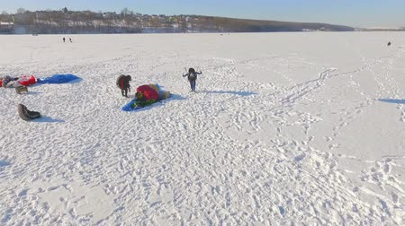 szybowiec : aerial view. Competitions pilots paragliding on a frozen lake near the city park. Wideo