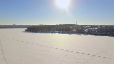 parachuting : aerial view. Winter vacation on the frozen lake. Snowmobile, Stock Footage