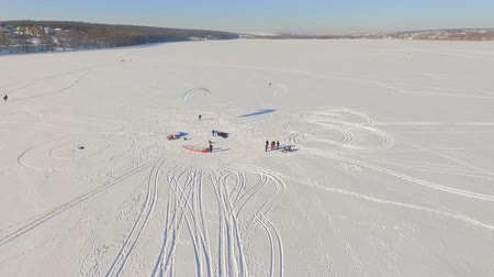 parachuting : aerial view. Winter vacation on the frozen lake. horseback riding