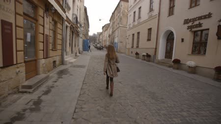 lviv : girl is walking down the street