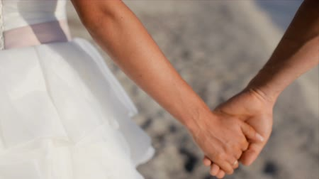forever : bride and groom take each others hands. Stock Footage