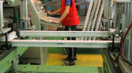 laboring : Workers in workshop. Line production of plastic windows.