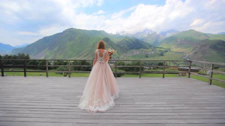 tampado : Beautiful girl on a background of a mountain landscape. Wedding day