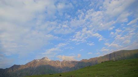 gürcü : green slopes of mountains and a blue sky with white clouds on a summer sunny day. Georgia