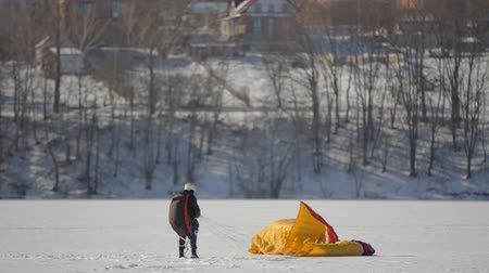 padák : Competitions of paraglider pilots on the frozen lake. Ternopil Ukraine