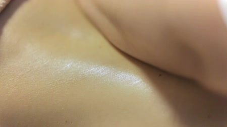 revitalizing : Back massage close-up.