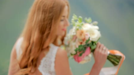 fiancee : Gorgeous red-haired bride with a bouquet of flowers