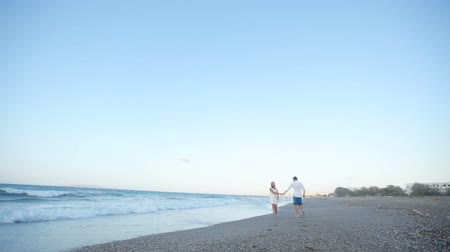 forever : A guy and a girl are having fun on the beach Stock Footage
