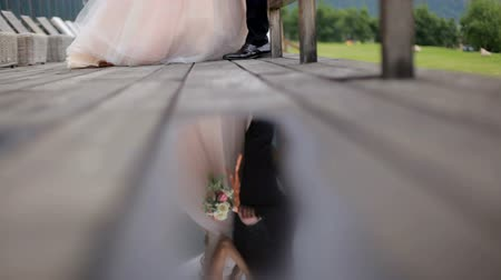 taras : Romantic photosession of the newlyweds. Reflection in a puddle. Slow motion