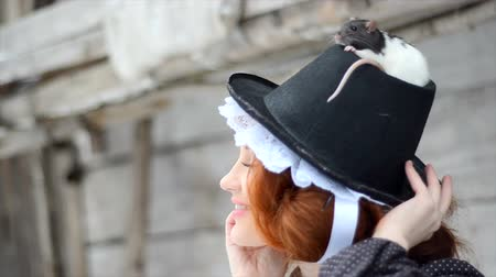 witchcraft : Beautiful red-haired girl posing with hand-made rat