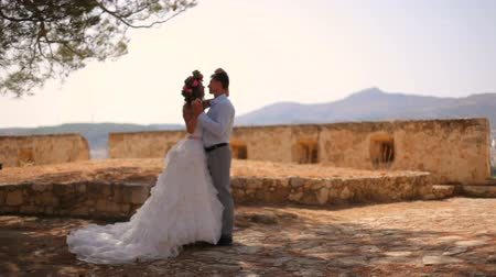 taş duvar : Wedding photosession of the newlyweds in Greece. Slow motion