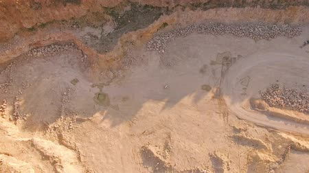 mirage : Quadrocopter flies over the deep yellow gorge. A pianist is playing on a white piano on yellow sand. View from above. Aerial view. Stock Footage