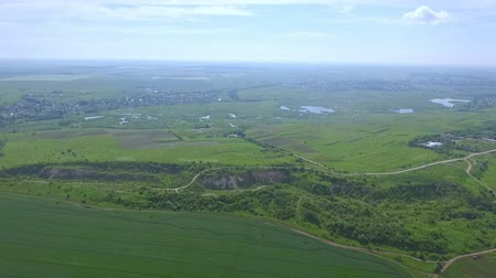 grit : Scenic view of the green plain with fields, groves, lakes and ravines from a birds eye view on a summer day
