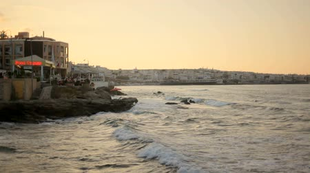 crete : Wonderful evening seascape. Hotels along the sea coast. Stock Footage