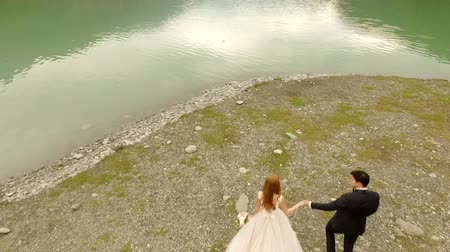věčnost : Beautiful and happy bride and groom on the river bank. Dostupné videozáznamy