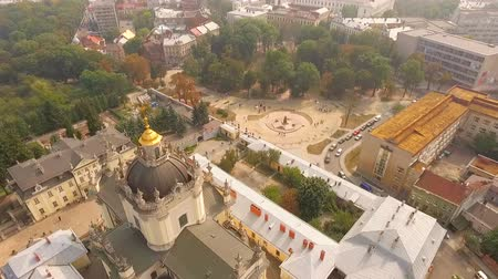 юра : Aerial view . Beautiful view of the city and the magnificent Catholic temple from a birds-eye view. Ukraine.