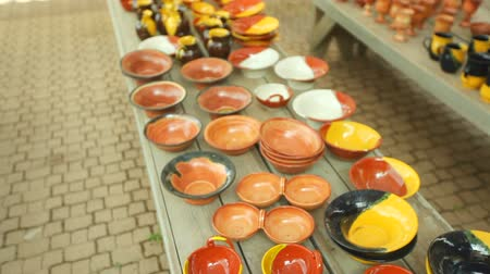 глина : Pottery handmade, Beautiful vessels, cups, dishes and souvenirs Стоковые видеозаписи