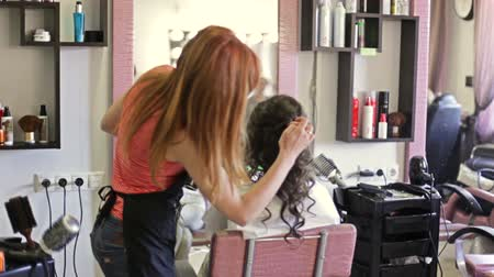 barbering : stylist makes womans hairdress in an art salon.
