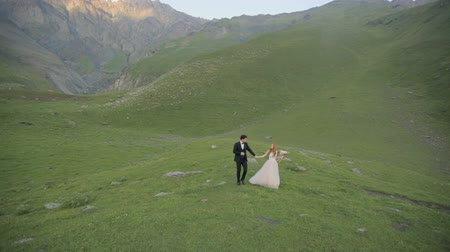unutulmayan : Unforgettable romantic walk of the bride and groom on their wedding day among the most beautiful mountains of Georgia